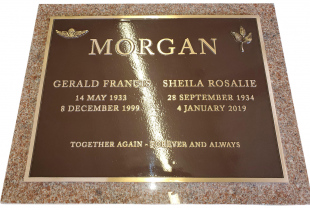 Double Bronze Plaque on Pacific Red Granite