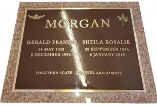 Double Bronze Plaque on Pacific Red Granite