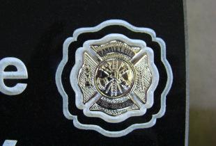 Bronze Emblem on Ebony Black Granite